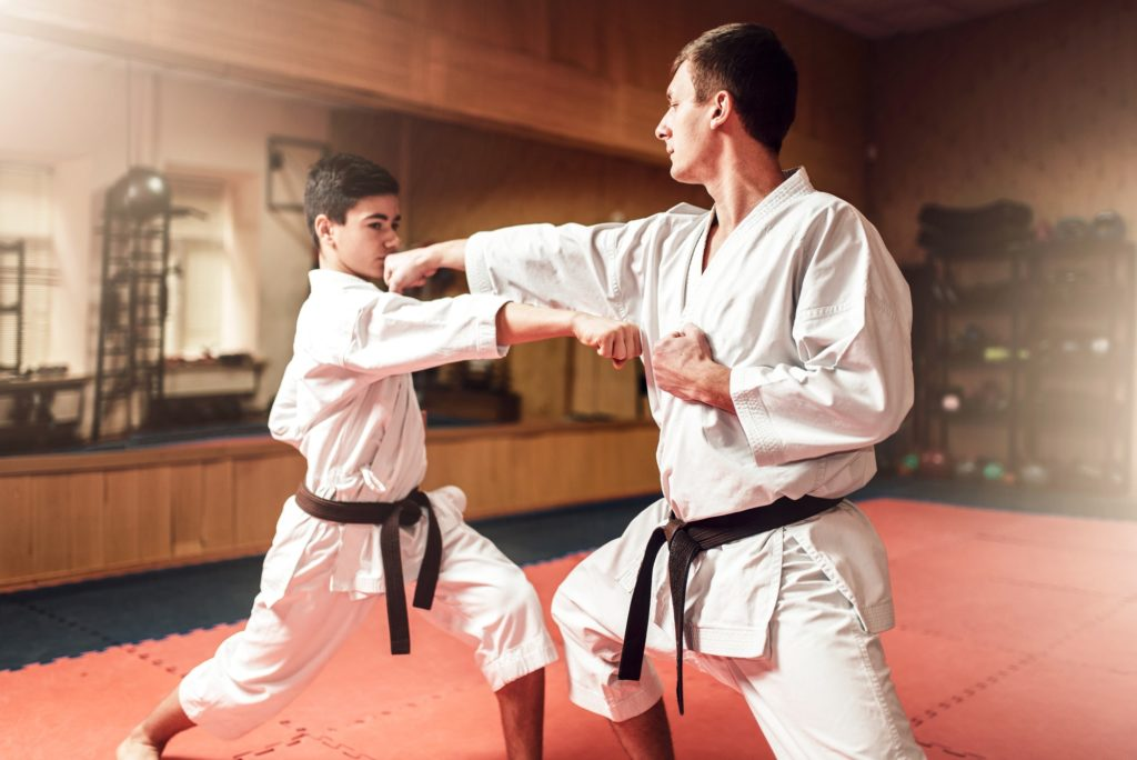 Martial arts masters, self-defence practice in gym